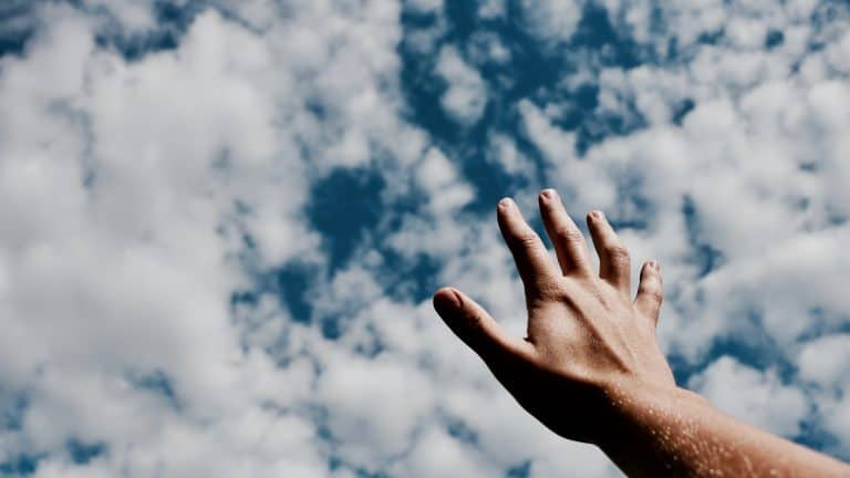 Hand against cloud archive for data backup page